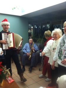 Christmas caroling at a nursing home.